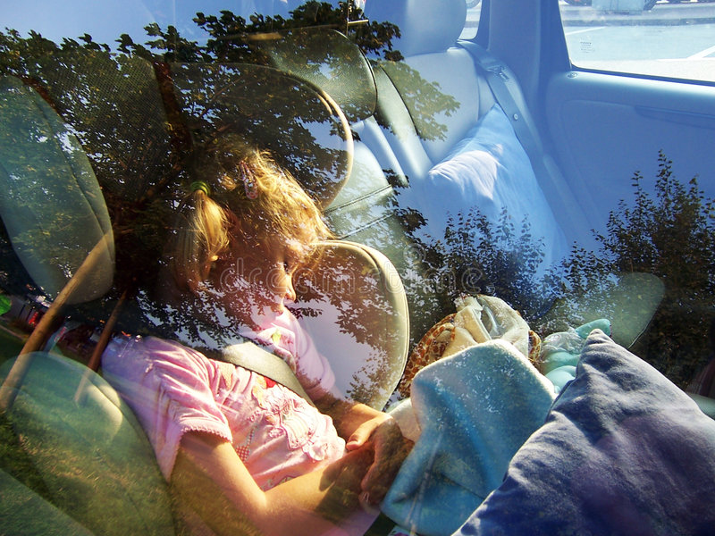 Cute girl sleeping in car royalty free stock images