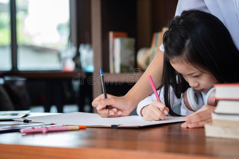Cute girl smiled and sitdown to drawing a book in the library, c stock images
