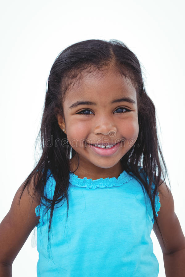 Cute girl smiling at the camera stock image