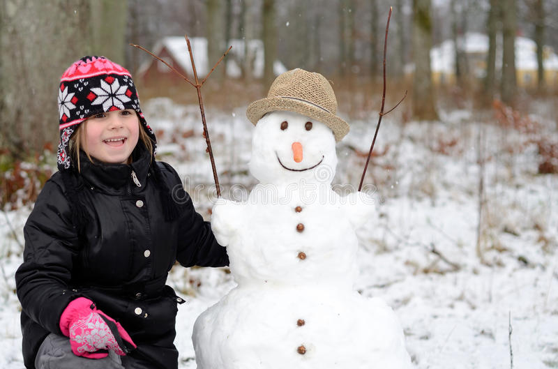 Download Cute girl with snowman stock photo. Image of outdoor - 22963830