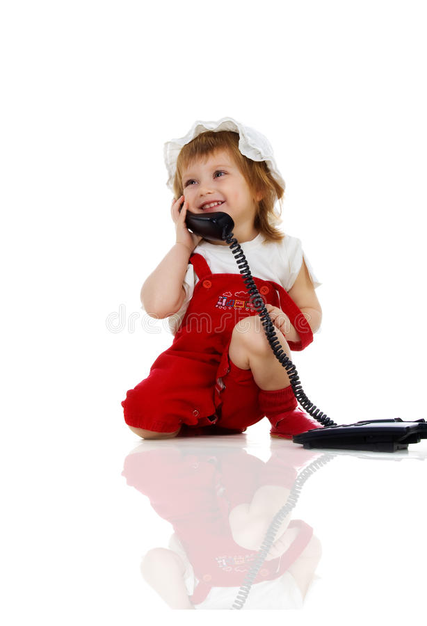 Free Cute Girl Speaks On The Phone Royalty Free Stock Image - 12493186