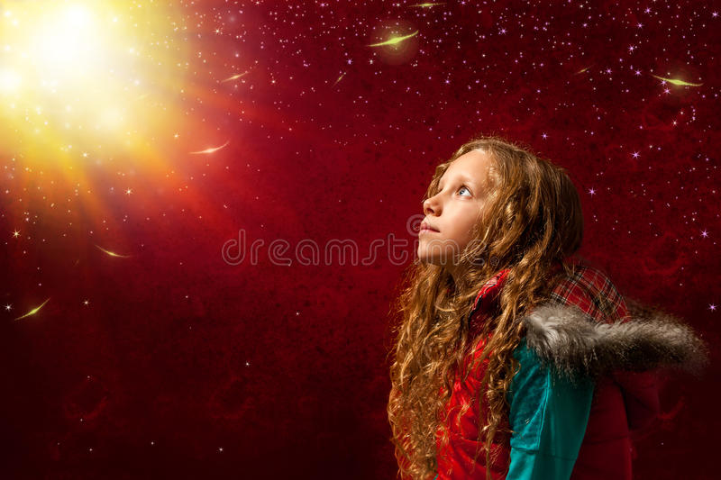 Cute girl staring at bright sunlight. royalty free stock images