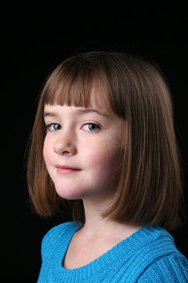 Cute girl with straight hair and a sideways glance stock photos