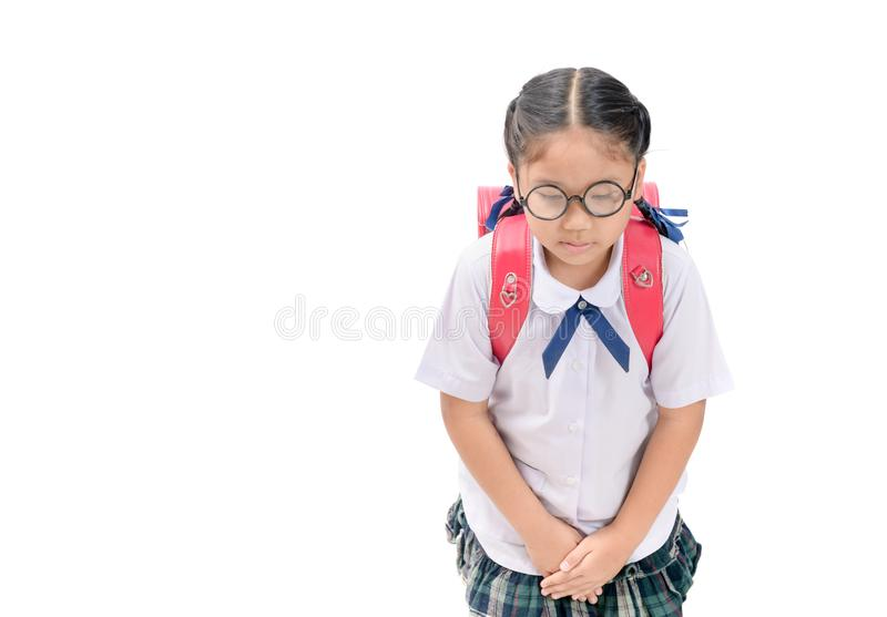 Cute girl student making a bow isolated stock photography