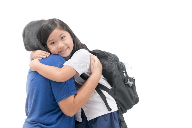 Cute girl student smile and hug her mother stock photography