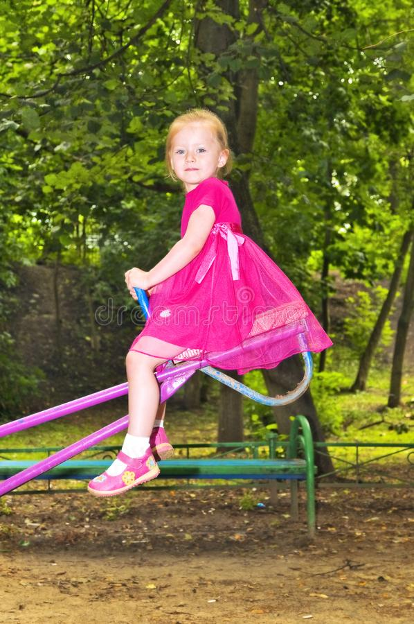 Cute girl on swings royalty free stock images