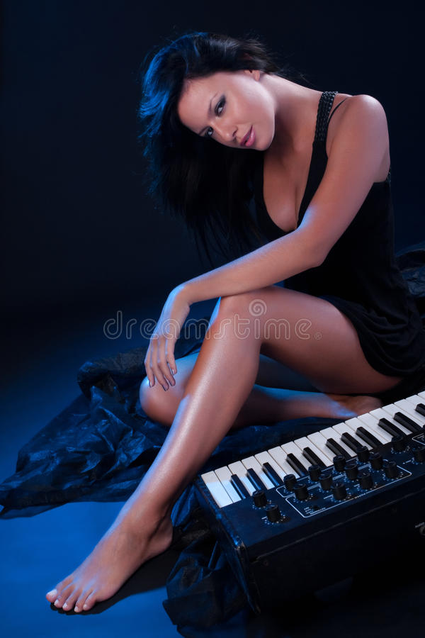 Cute Girl With Synthesizer Royalty Free Stock Photos