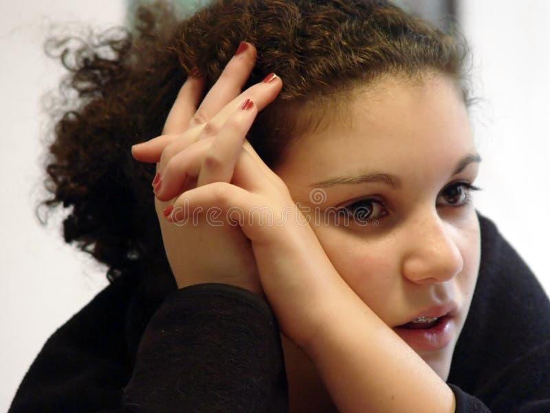 Cute girl thinking hard royalty free stock photography