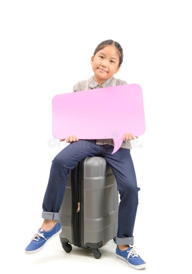 Cute girl traveler sit on suitcase and holding speech bubble stock image