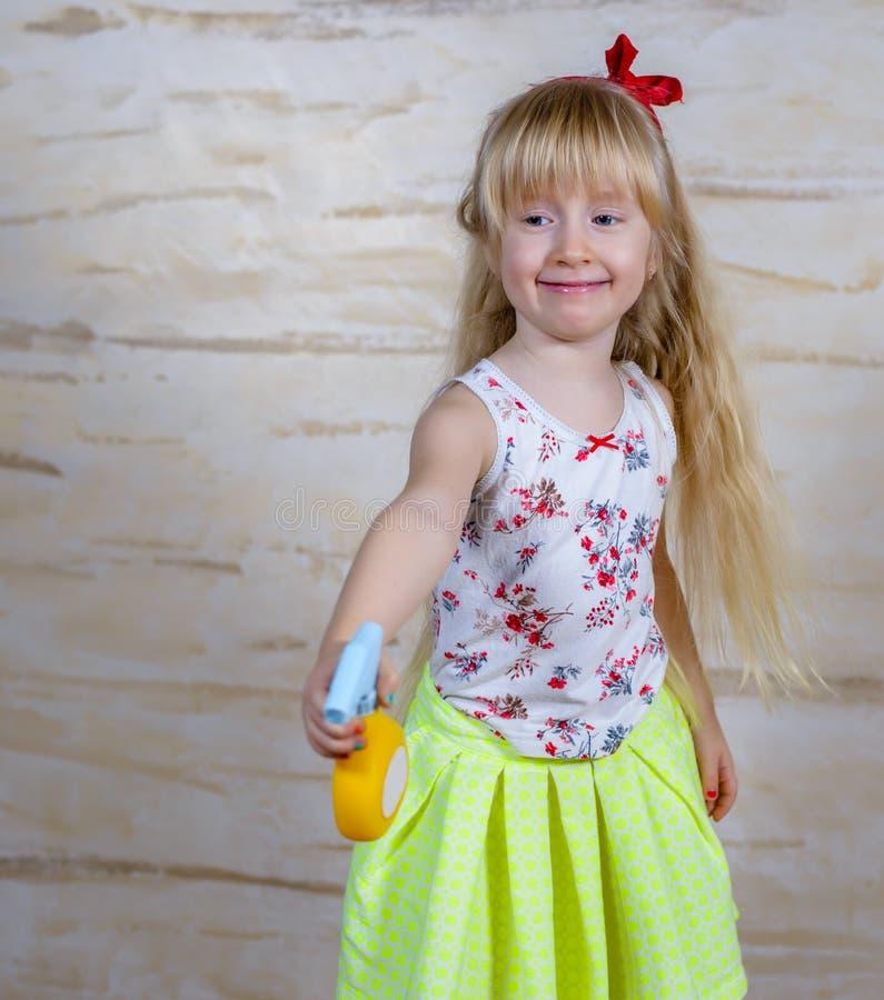 Cute girl using spray bottle stock photography