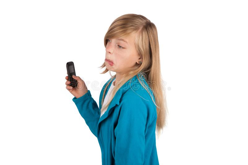 Cute girl very disappointed because she got only a simple mobile royalty free stock images