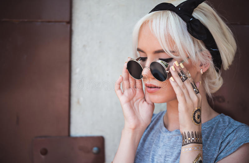 Cute girl in vintage sunglasses outdoors royalty free stock photography