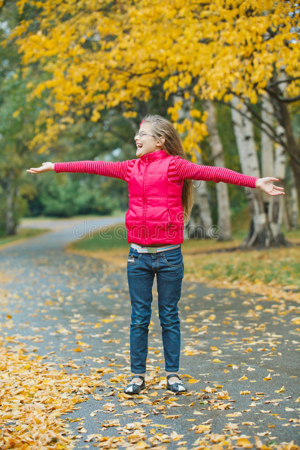 Download Cute Girl Walking In The Autumn Park Stock Photo - Image: 21510778
