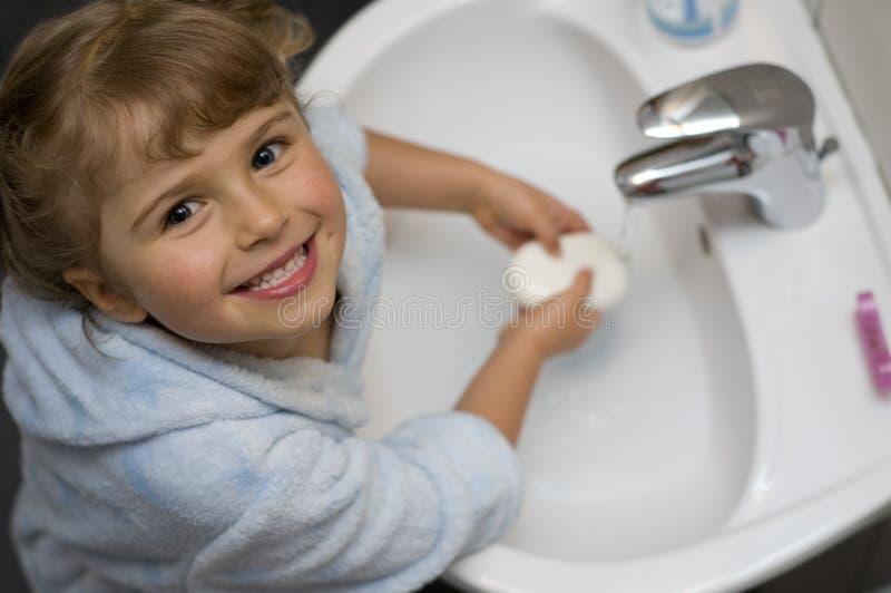 Cute girl washing hands royalty free stock photo