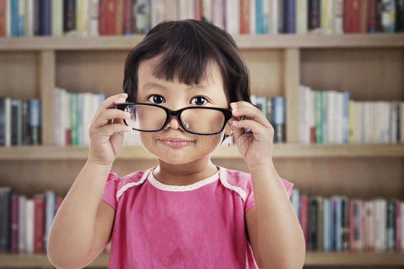 Cute girl wearing glasses stock photography