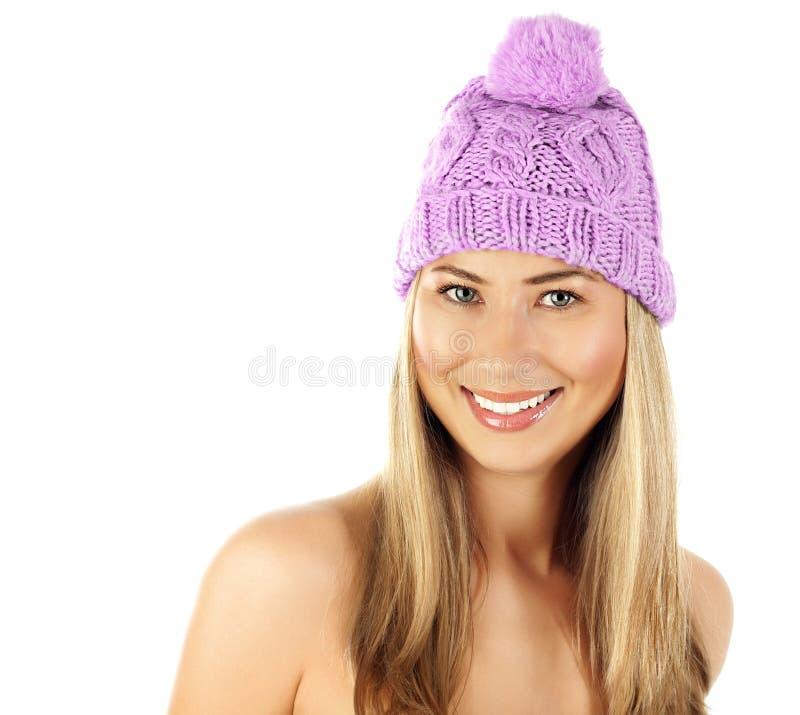 Cute girl wearing pink winter hat stock photos
