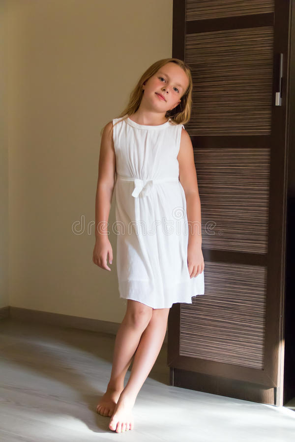 Cute girl in white dress royalty free stock photo