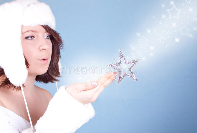 Download Cute  Girl In White Hat Blowing A Snow Stock Photo - Image: 12202320