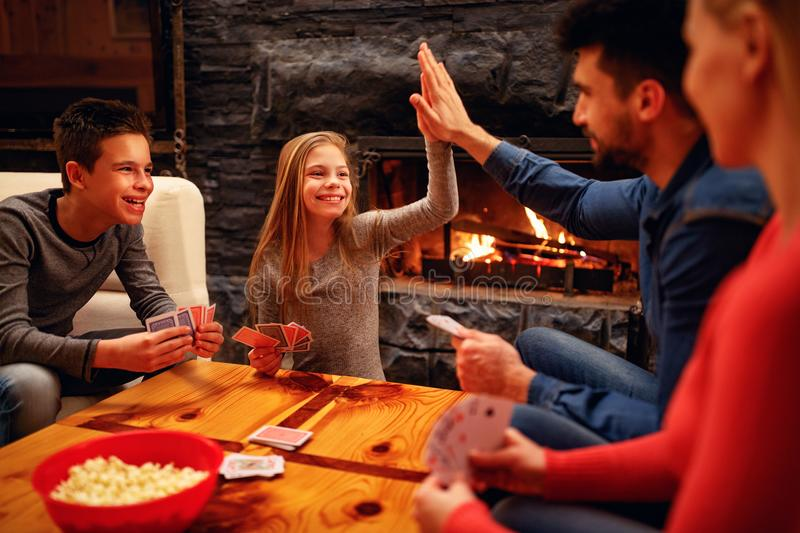 Cute girl won in the card game royalty free stock photo