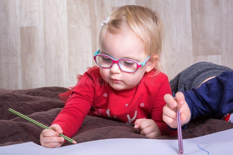 Cute girl writting letter for Santa royalty free stock image