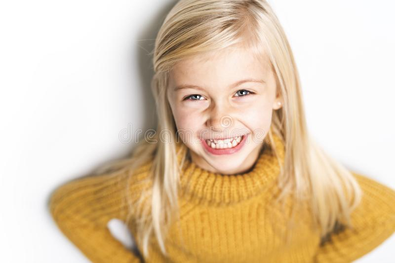 A Cute girl 5 year old posing in studio stock images