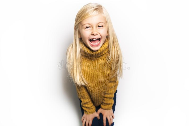 A Cute girl 5 year old posing in studio royalty free stock photo