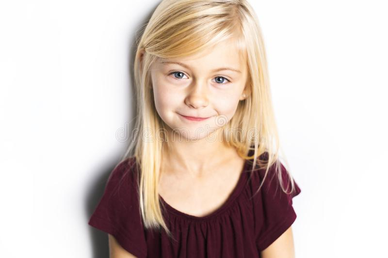 A Cute girl 5 year old posing in studio royalty free stock images