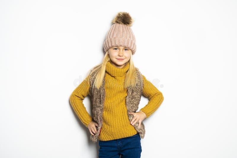 A Cute girl 5 year old posing in studio on autumn season studio royalty free stock photography