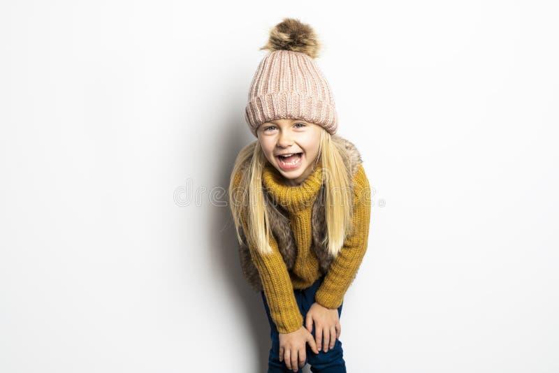 A Cute girl 5 year old posing in studio on autumn season studio stock photos
