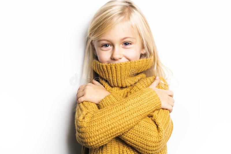 A Cute girl 5 year old posing in studio with frozen look, royalty free stock images