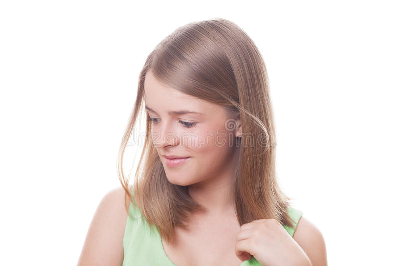 Cute girl. Cute young pensive and smiling girl on isolated white stock photos