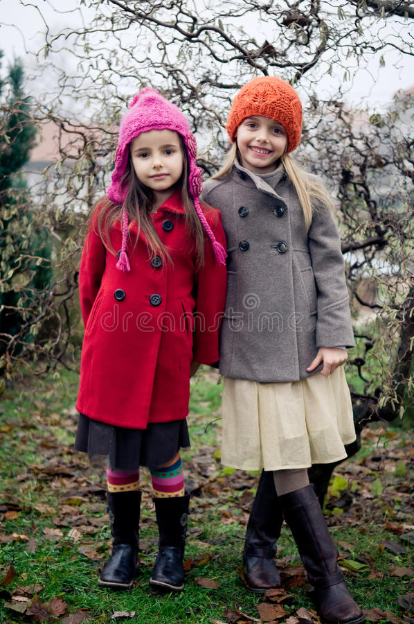 Cute girls in retro clothes royalty free stock photo