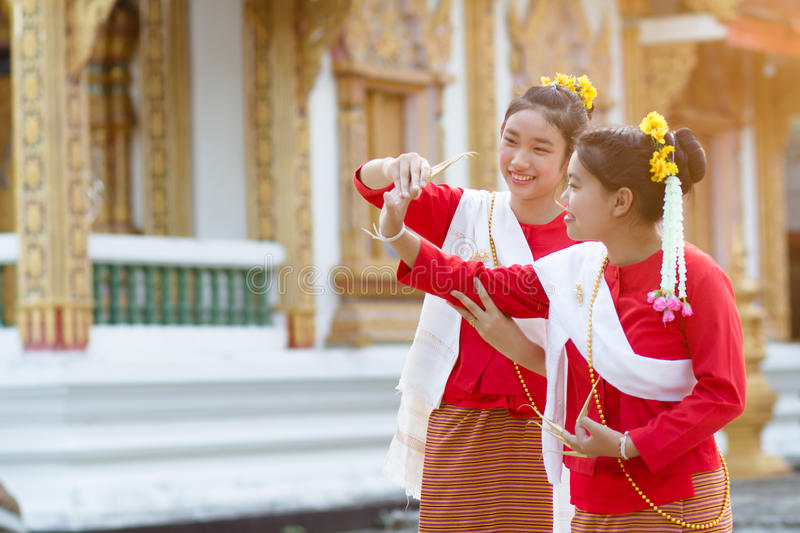Cute girls in Thai tradition costume royalty free stock images