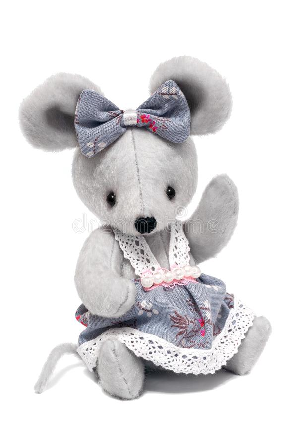 Cute gray toy mouse in a dress  on white background royalty free stock images