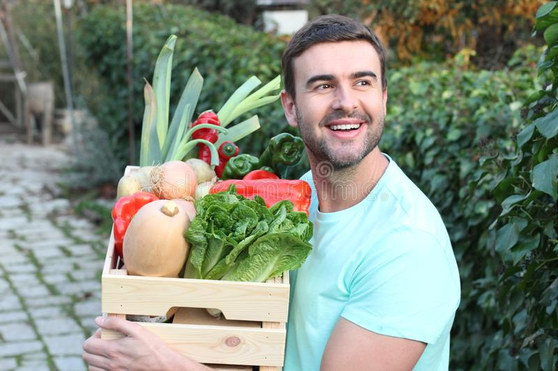 Cute guy holding basket with natural food stock image