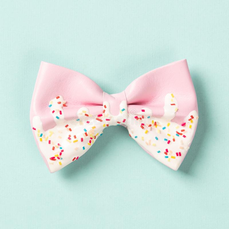 Cute hair bow on bright background, flat lay. Top view royalty free stock photos