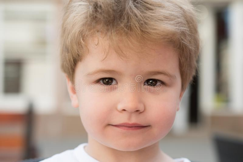 Cute hairstyle for short hair. Little child with stylish haircut. Little child with short haircut. Small boy with blond. Hair. Healthy haircare tips for kids stock image