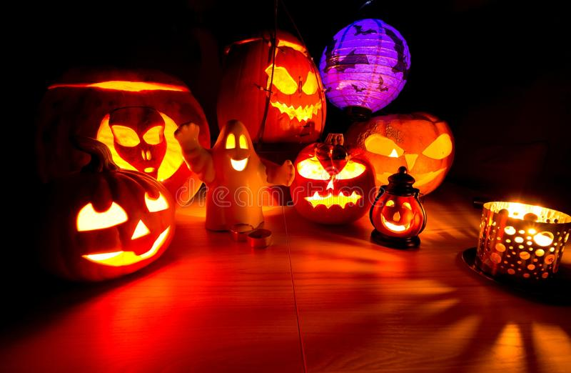 Cute Halloween pumpkins at night - halloween party background. Cute Halloween pumpkins at night - halloween party cute background royalty free stock photo