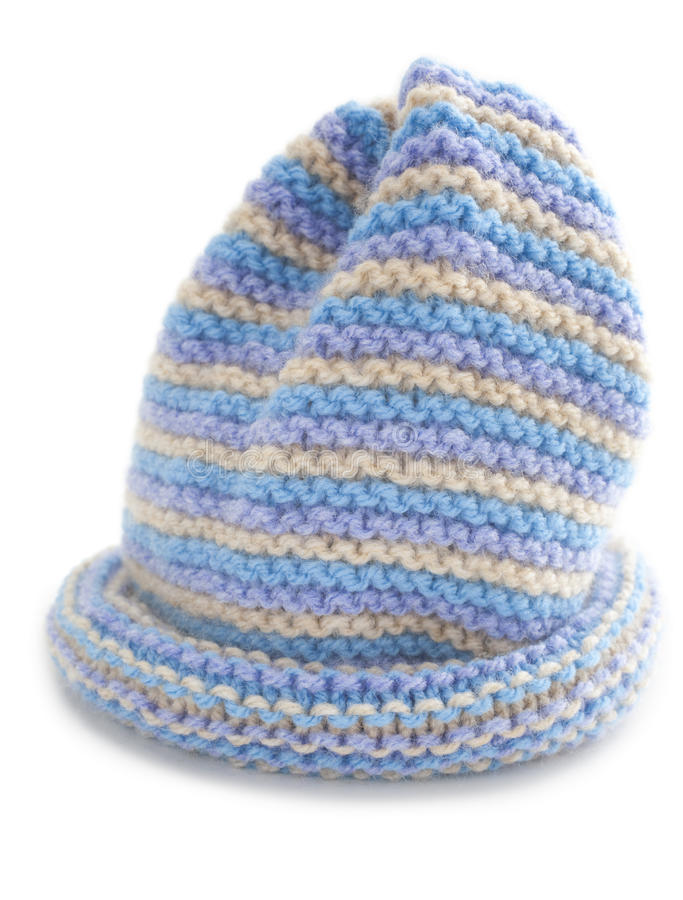 Cute Hand Knitted Baby Hat. Cute baby's hat, hand knitted in garter stitch stripes stock photo