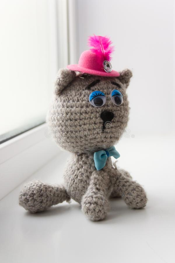 Cute hand made knitted grey cat stock photography