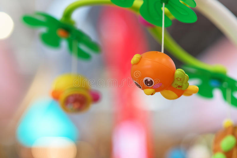 Cute hanging bird toy for baby. Development, Selected focus at bird stock illustration