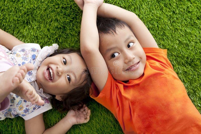 Cute happy asian siblings