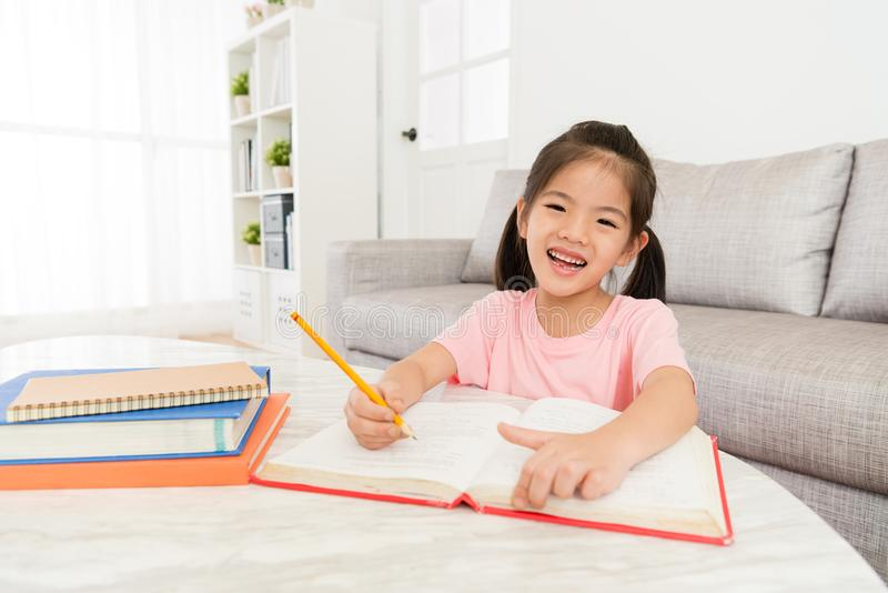 Cute happy girl kid student writing studying book royalty free stock photos