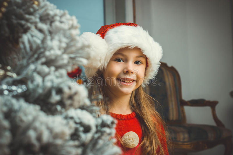 Cute happy girl in red hat royalty free stock photo