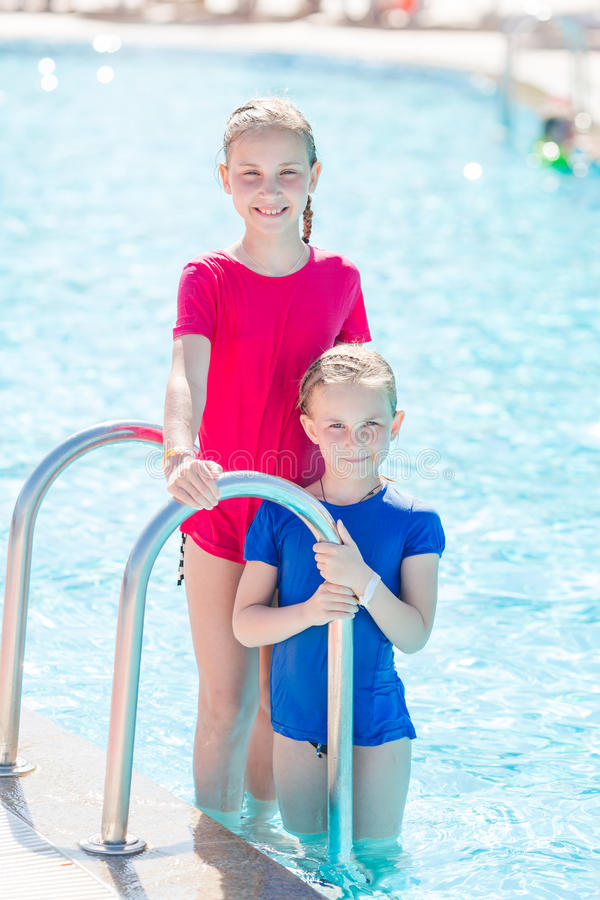 Free Cute Happy Girls At The Pool Royalty Free Stock Image - 74188996