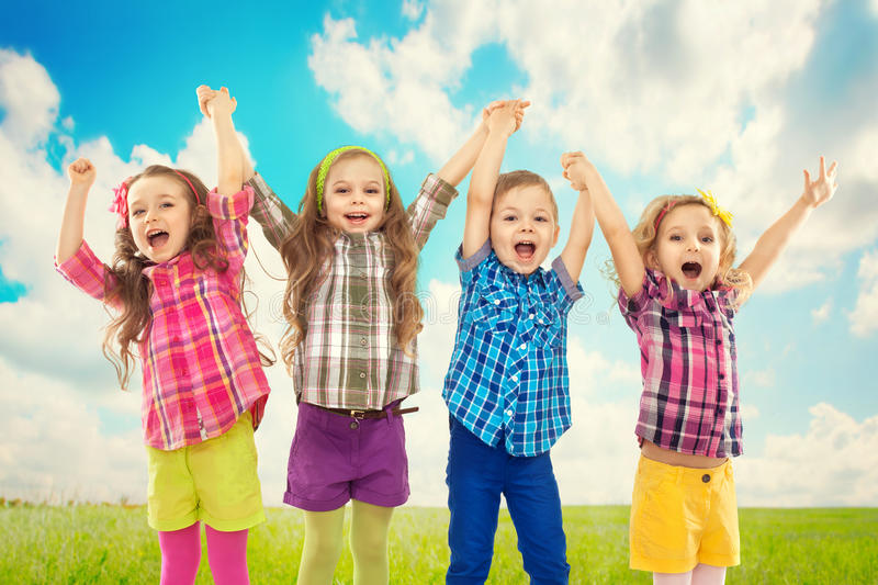 Cute happy kids are jumping together stock photography