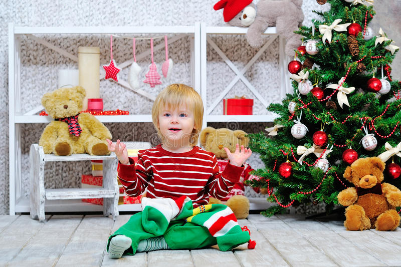 Cute and happy little boy and Christmas stocking stock photography