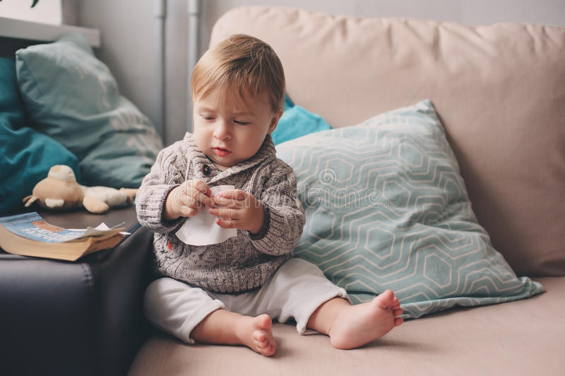 Cute happy 11 month baby boy playing at home, lifestyle capture in cozy interior royalty free stock images