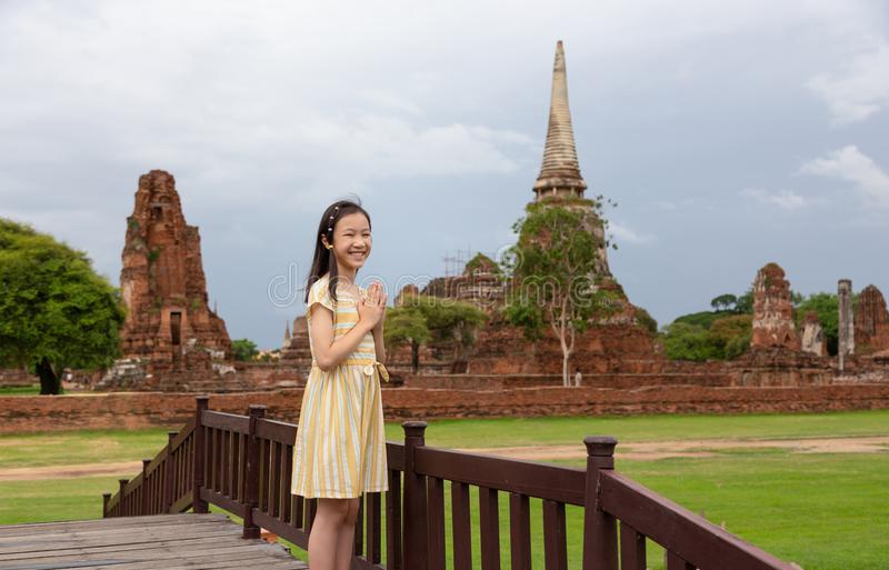Cute happy smiling tourist girl,Asian cute girl with pay respect royalty free stock photo