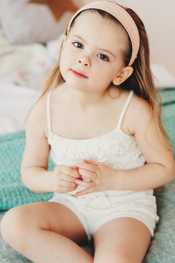 Free Cute Happy Toddler Girl Sitting On Bed In Pajama. Child Playing At Home Royalty Free Stock Images - 97119989